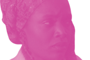 A Black woman wearing an orange patterned headscarf cradles her face with the palm of her left hand.